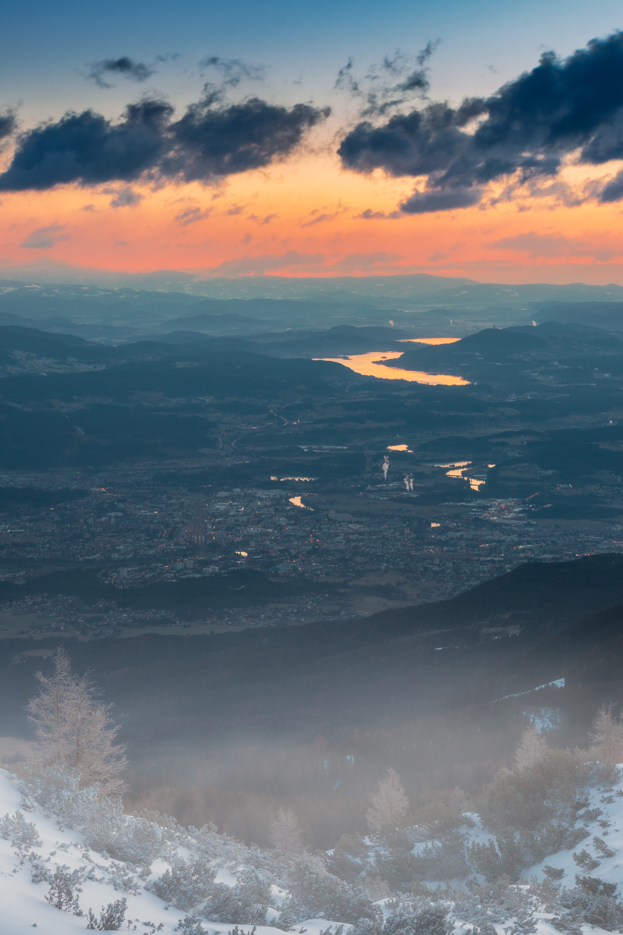 Sunrise View from the Dobratsch Mountain - City of Villach and Lake Woerthersee / Wörthersee