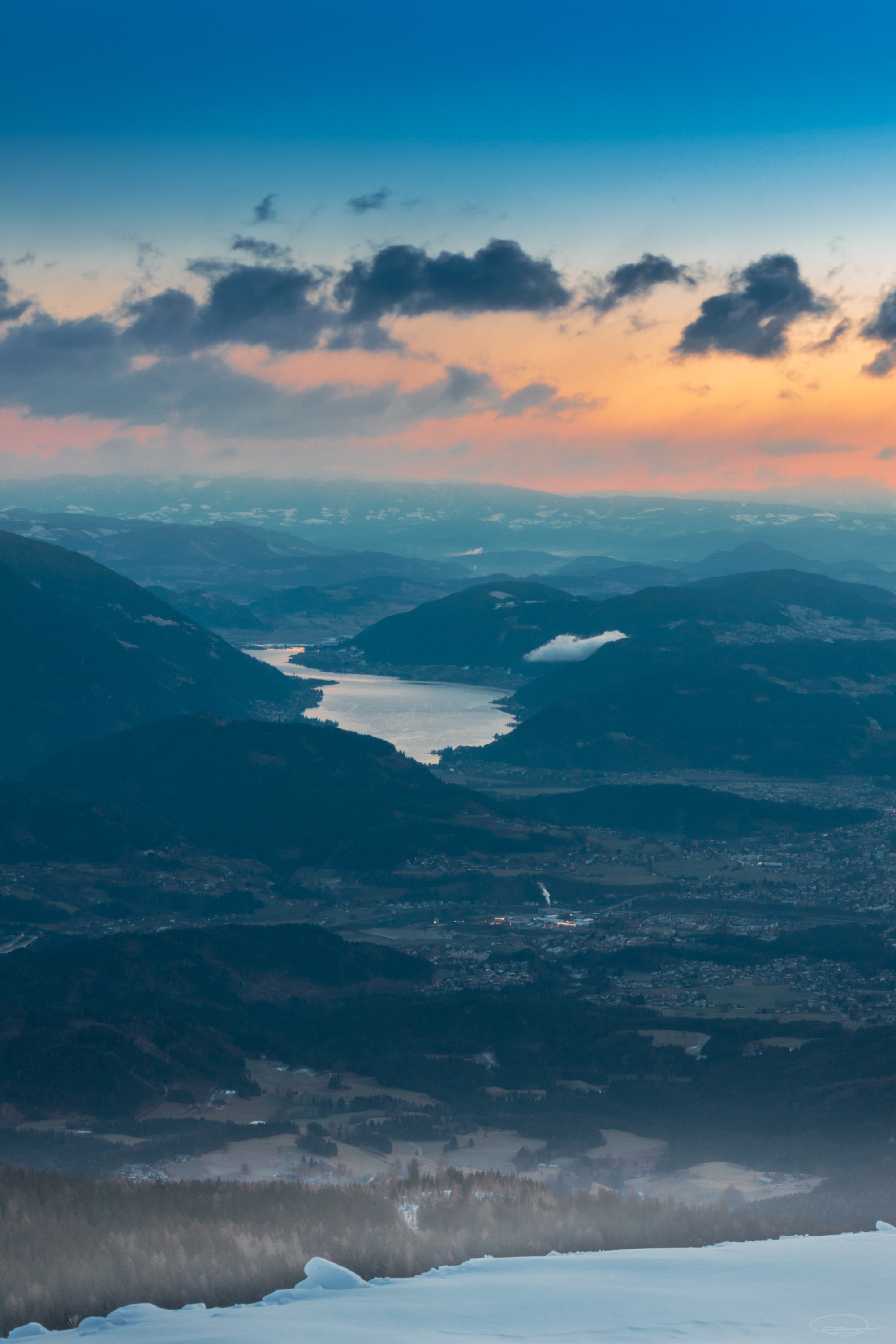 Sunrise View from the Dobratsch Mountain - City of Villach and Lake Ossiach